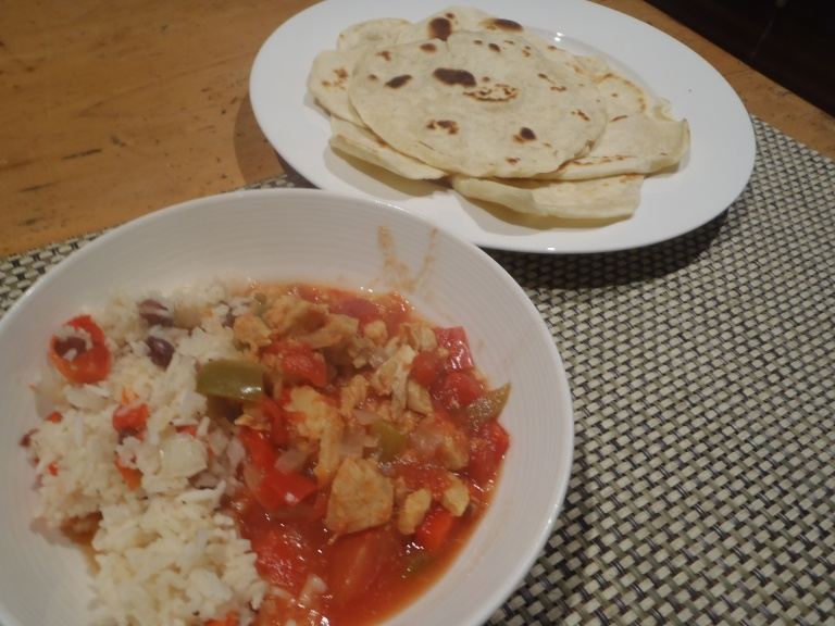 Rice and beans with stew and tortillas